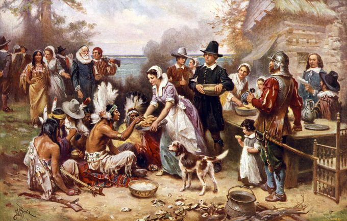The first Thanksgiving, 1621, Pilgrims and natives gather to share a meal, oil painting by Jean Louis Gerome Ferris