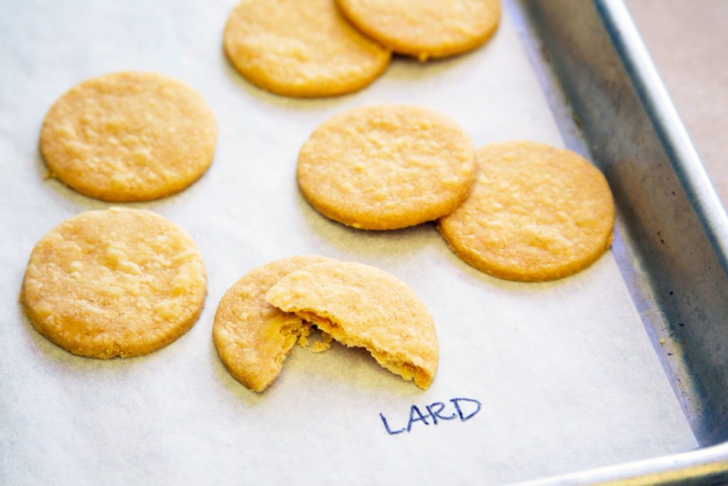 "Pie crust with lard taste test - cookie-shaped pieces shown on a baking sheet labeled with ""lard"""
