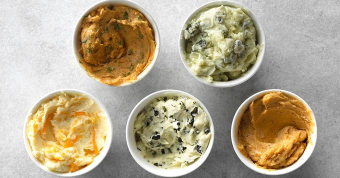 Five different flavors of butters in separate cups