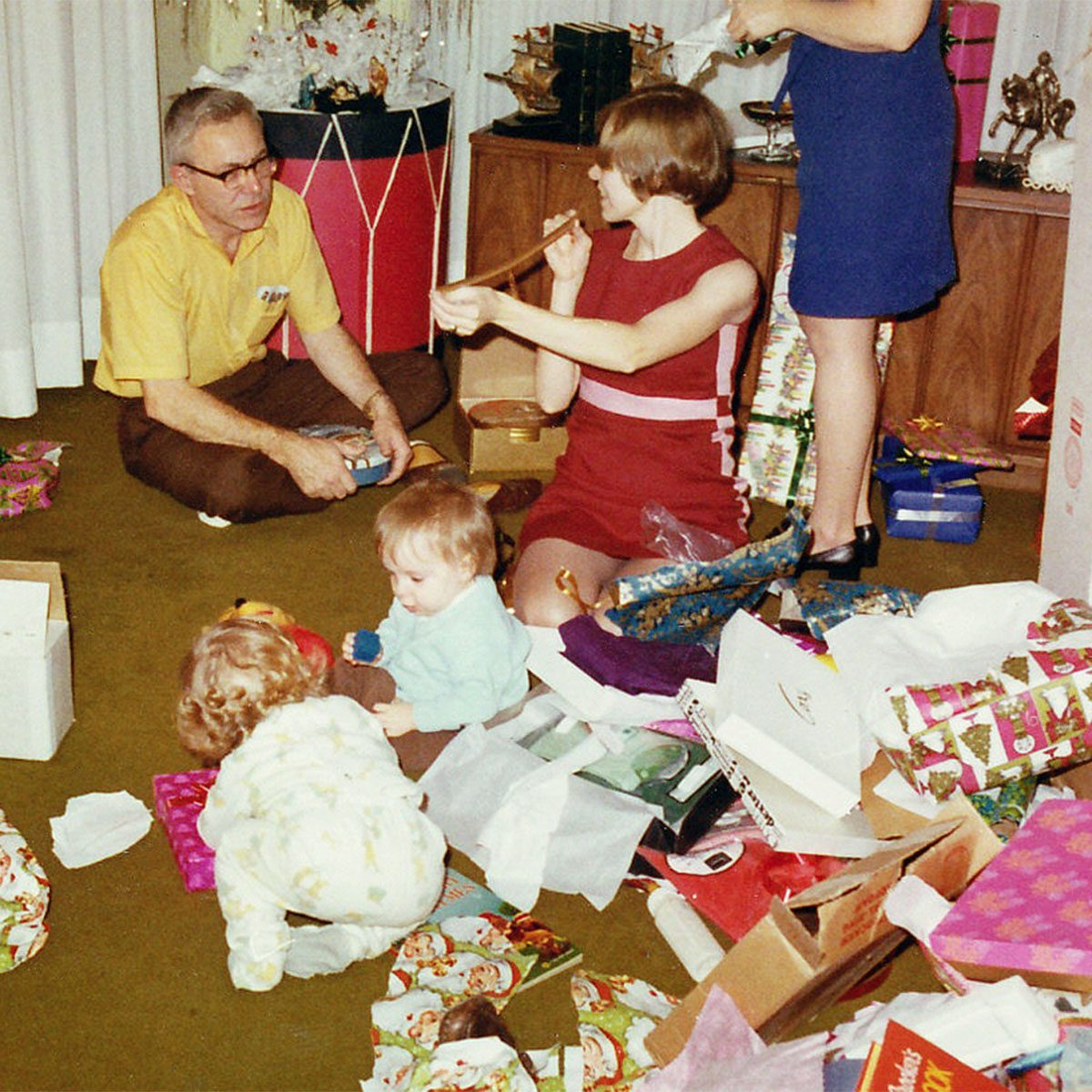 Family opening presents on Christmas Day