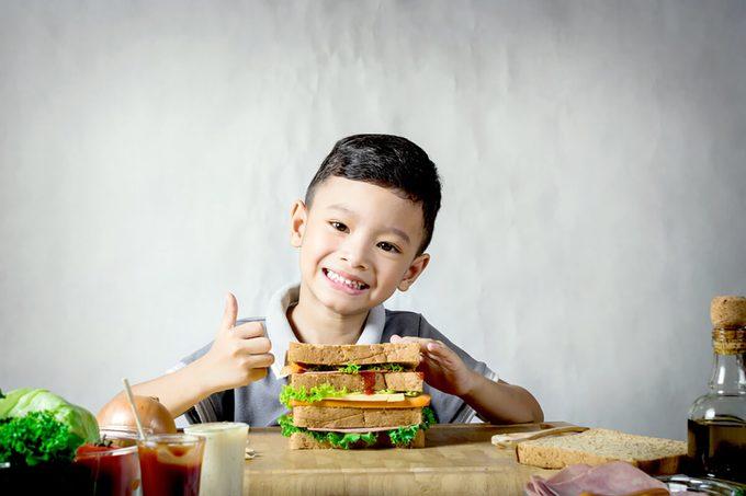 Little Boy Making a Sandwich In Kitchen