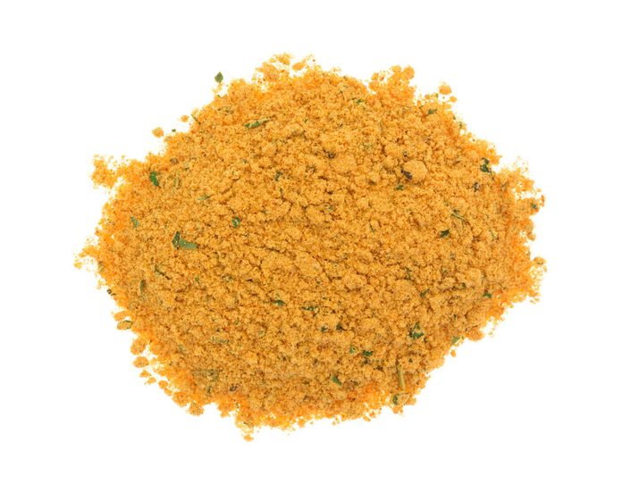 A portion of dry mesquite marinade ingredients isolated on a white background.