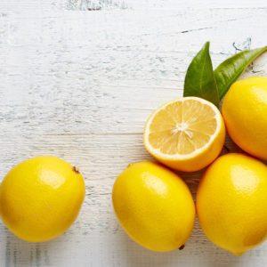 fresh ripe lemons on wooden table