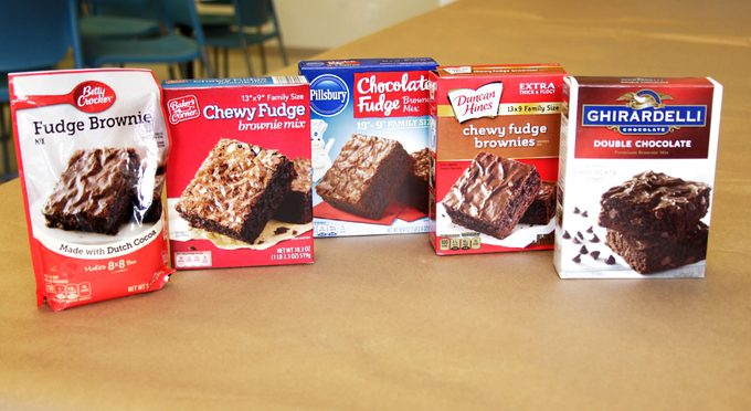 Line-up of different brands of brownie mix