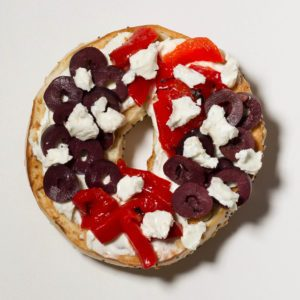 Bagel topped with cream cheese; chopeed kalamata olives; roasted red peppers; grated lemon peel