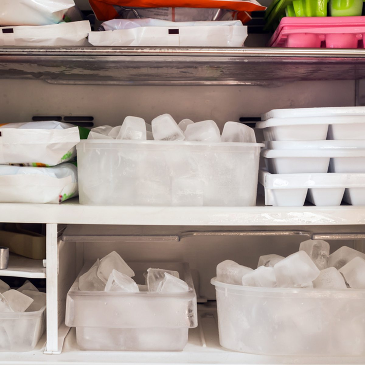 Freezer full of ice cubes and frozen food