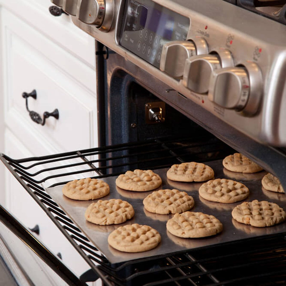 Tray of cookies coming out of the oven