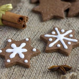Star shape Christmas chocolate gingerbread Cookie with icing and cinnamon on sacking