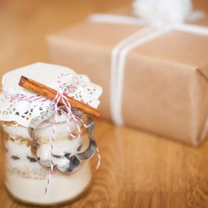 Dry mixing ingredients for chocolate chip cookies in a glass jar handmade gift