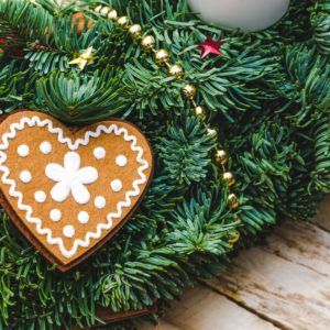 Advent Christmas wreath made natural pine with Heart shaped gingerbread cookie