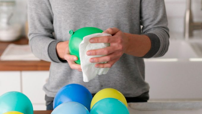 Cleaning balloons with a paper towel