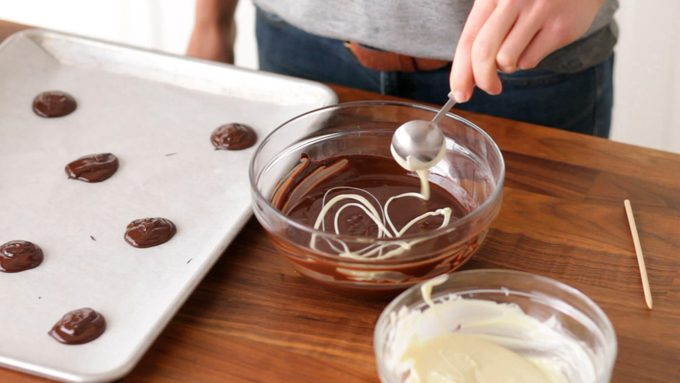 Drizzling white chocolate into bittersweet chocolate