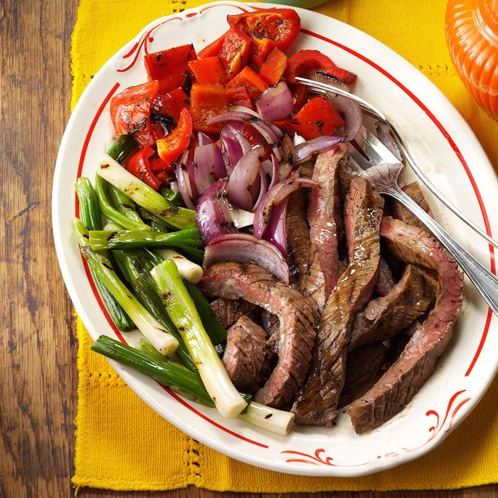 Grilled Skirt Steak with Red Peppers & Onions