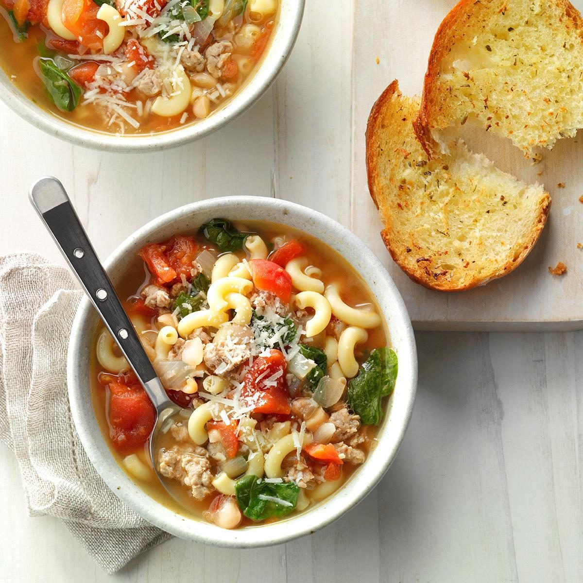 Bowls of Pasta Fagioli soup with French bread