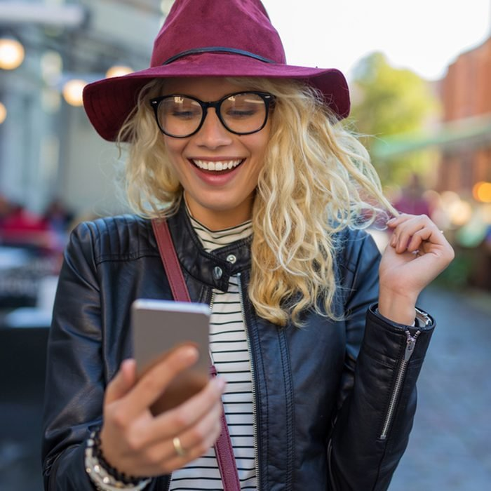 Happy and funny woman looking at her phone; Shutterstock ID 518846440; Job (TFH, TOH, RD, BNB, CWM, CM): Taste of Home