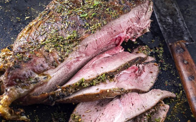 Barbecue Haunch of Venison on old Metal Sheet; wild game