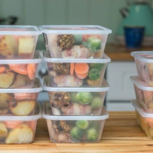 Meal prep. Stack of home cooked roast chicken dinners in containers ready to be frozen for later use as quick and easy ready meals