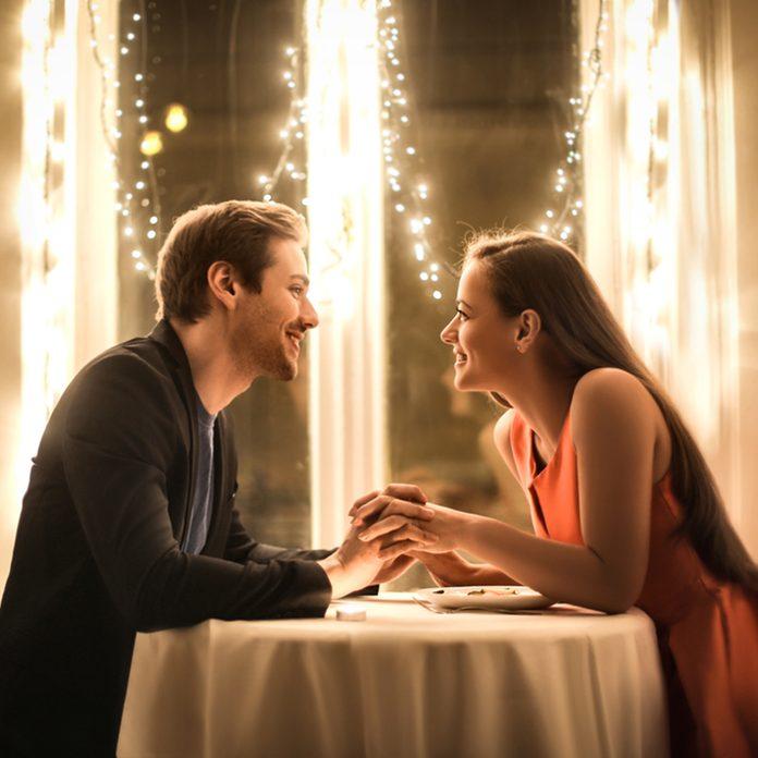 Sweet couple having a romantic dinner; Shutterstock ID 732835063