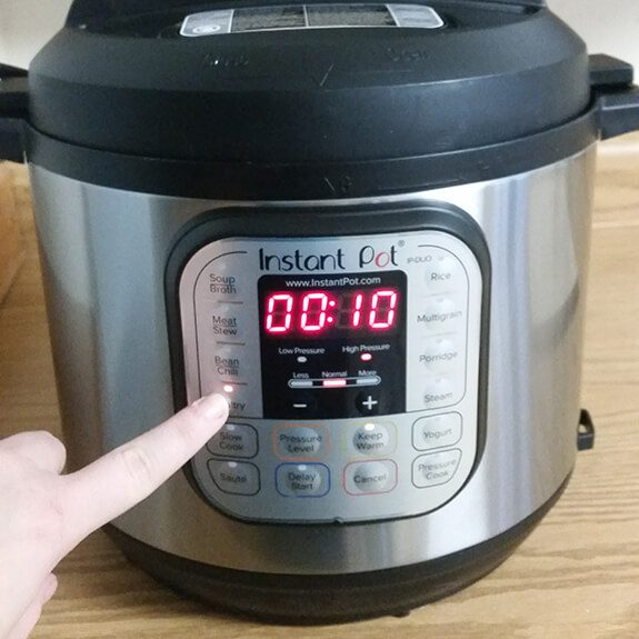 Person changing the settings of their instant pot