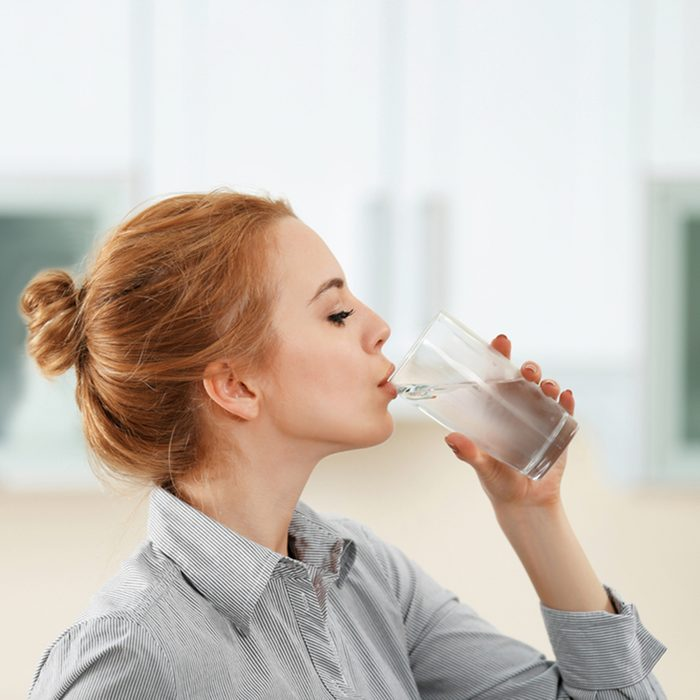 Young woman in the kitchen drinking water; Shutterstock ID 427251640; Job (TFH, TOH, RD, BNB, CWM, CM): TOH