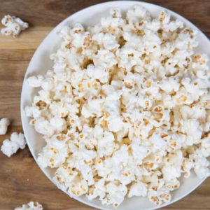 Fresh homemade popcorn in a white bowl