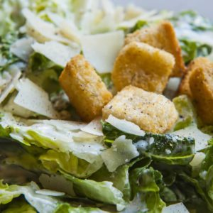 Cesar Salad in a salad bowl at a restaurant;