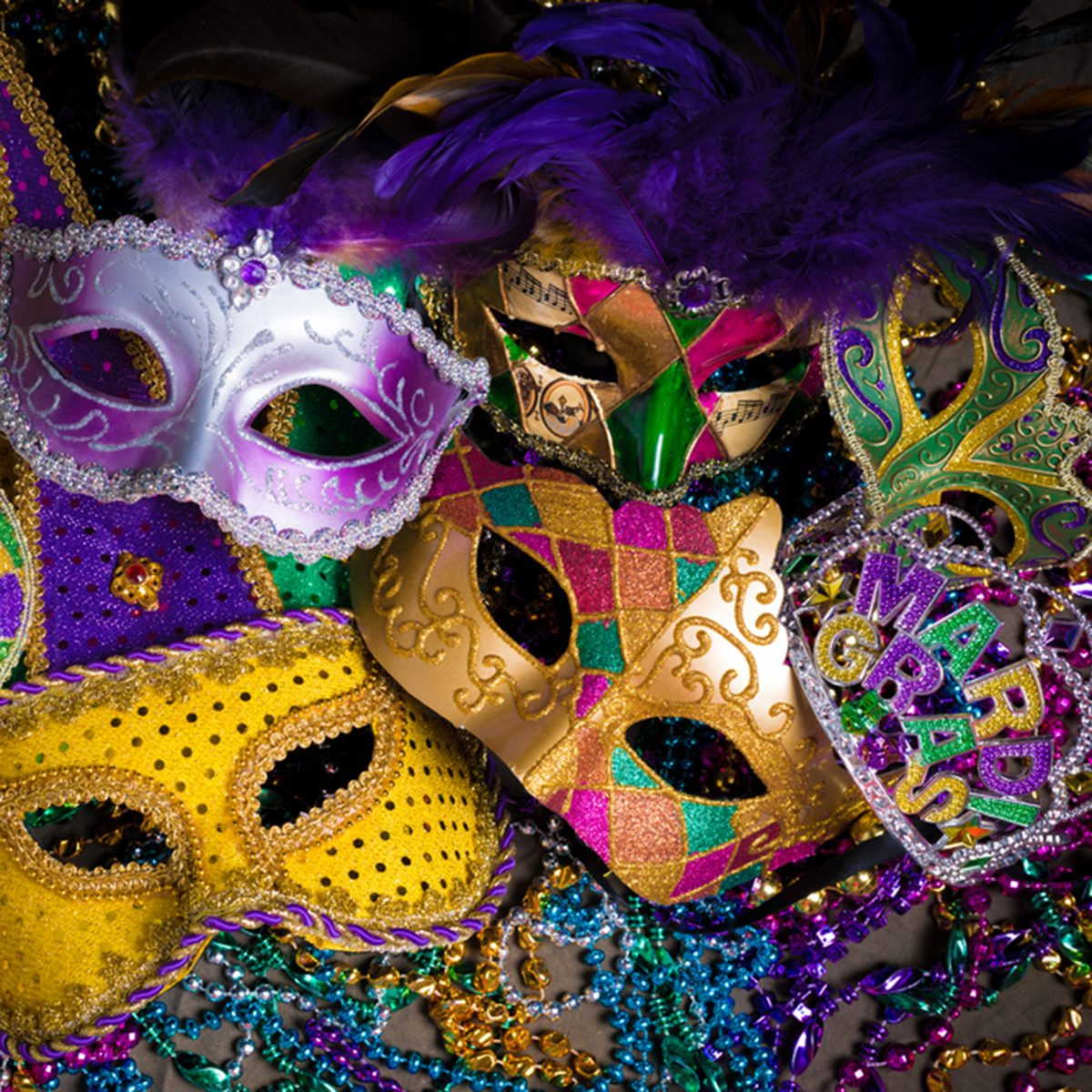 A group of venetian, mardi gras mask or disguise on a dark background; Shutterstock ID 247615072