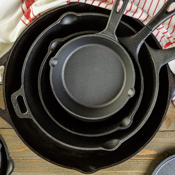 Cast iron skillet on rustic wood table.; Shutterstock ID 370808516
