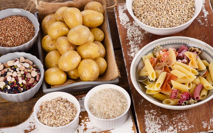 Healthy Food: Best Sources of Carbs on a wooden table. Top view
