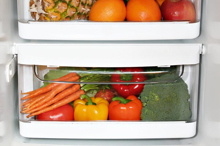 Fresh fruit and vegetables in a crisper drawer