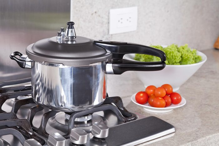 double valve pressure cooker, in a Kitchen setting;