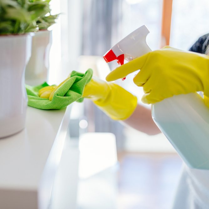 Woman wearing yellow rubber protective gloves and cleaning white shelf.; Shutterstock ID 546648748; Job (TFH, TOH, RD, BNB, CWM, CM): TOH DIY All-Purpose Cleaner