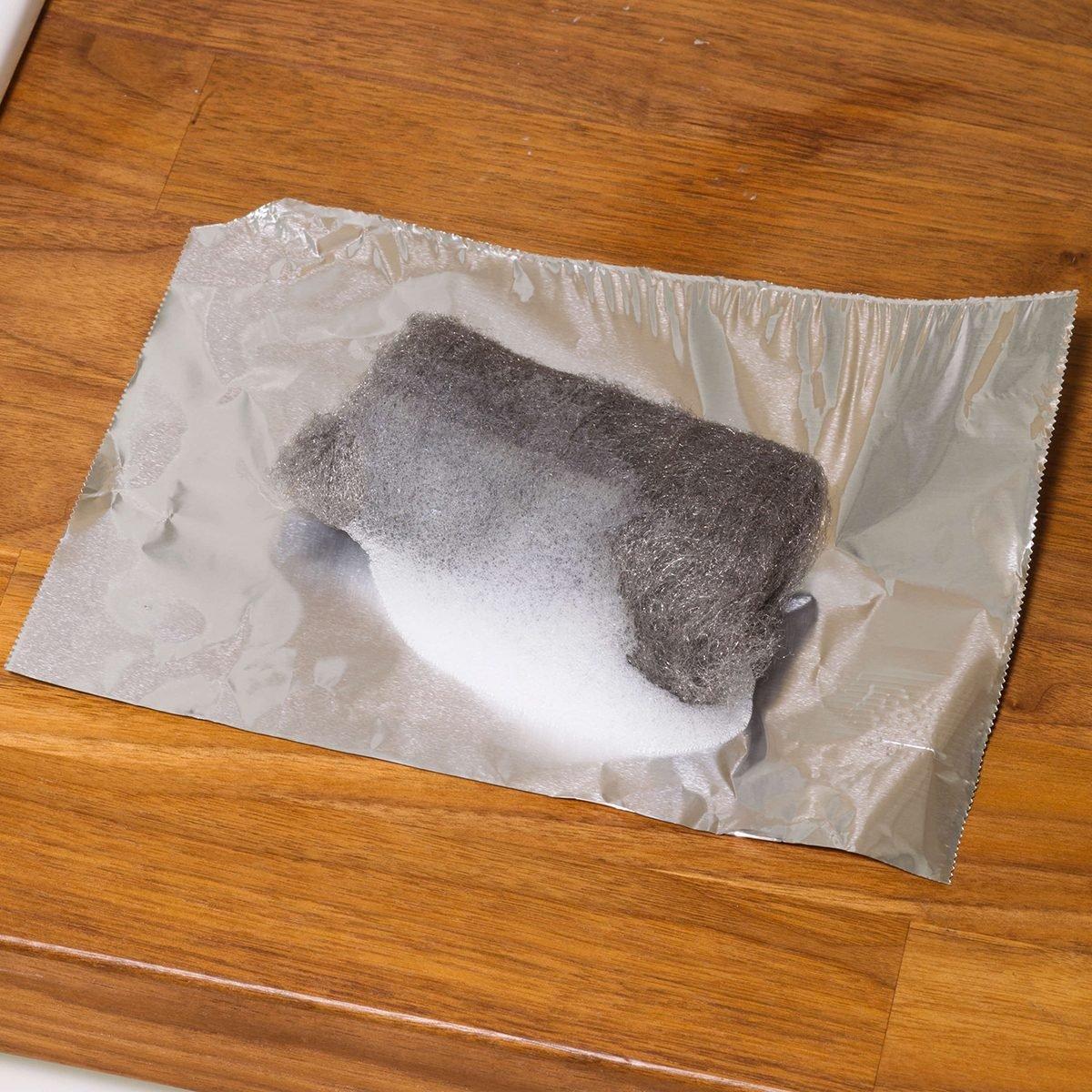 Steel wool on sheet of foil