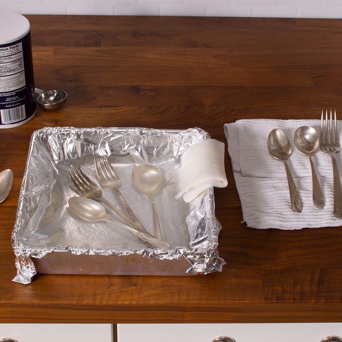 Silverware in a pan lined with foil