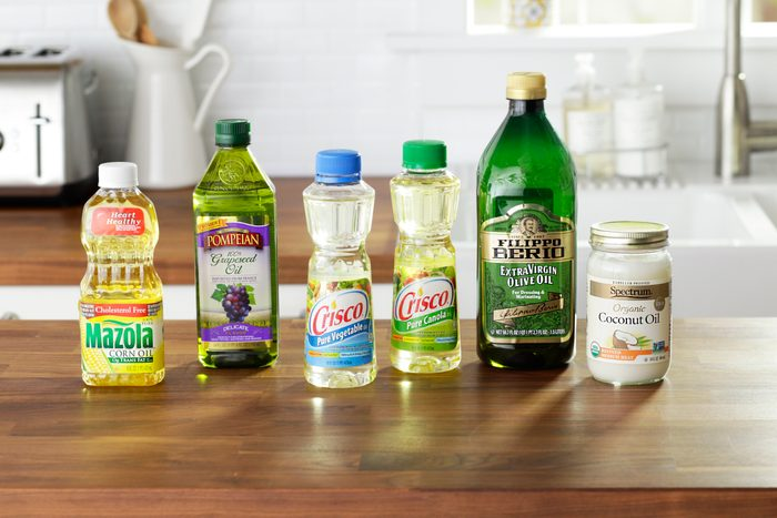 generic cooking oil bottles in kitchen environment