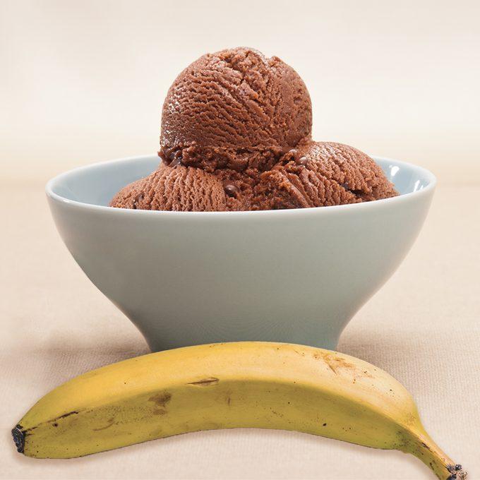 chocolate ice cream over a beige background