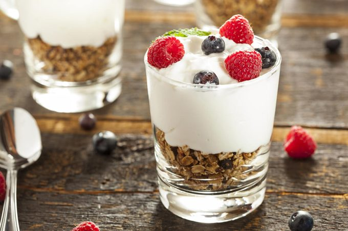 Homemade Organic Fresh Fruit Parfait with berries and granola