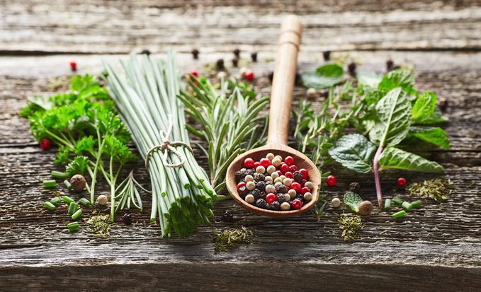 Keto-friendly Herbs and spices on a wooden background
