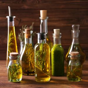 Composition of bottles with oil on wooden background; Shutterstock ID 594527645