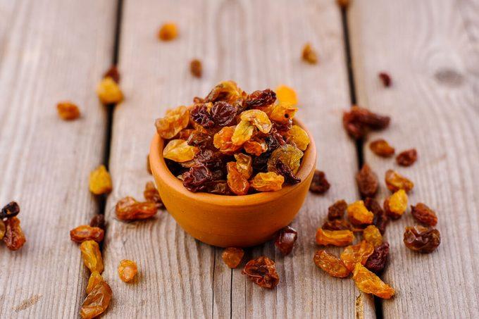 bowl of raisins. raisins on a wooden background