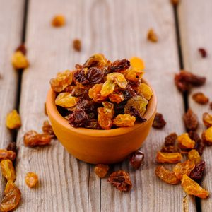 bowl of raisins. raisins on a wooden background