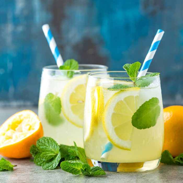Lemonade or mojito cocktail with lemon and mint, cold refreshing drink or beverage with ice