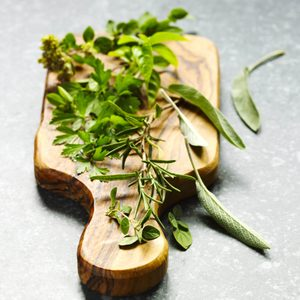 Herbs on cooking board