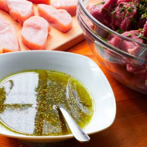 meat with marinade and herbs