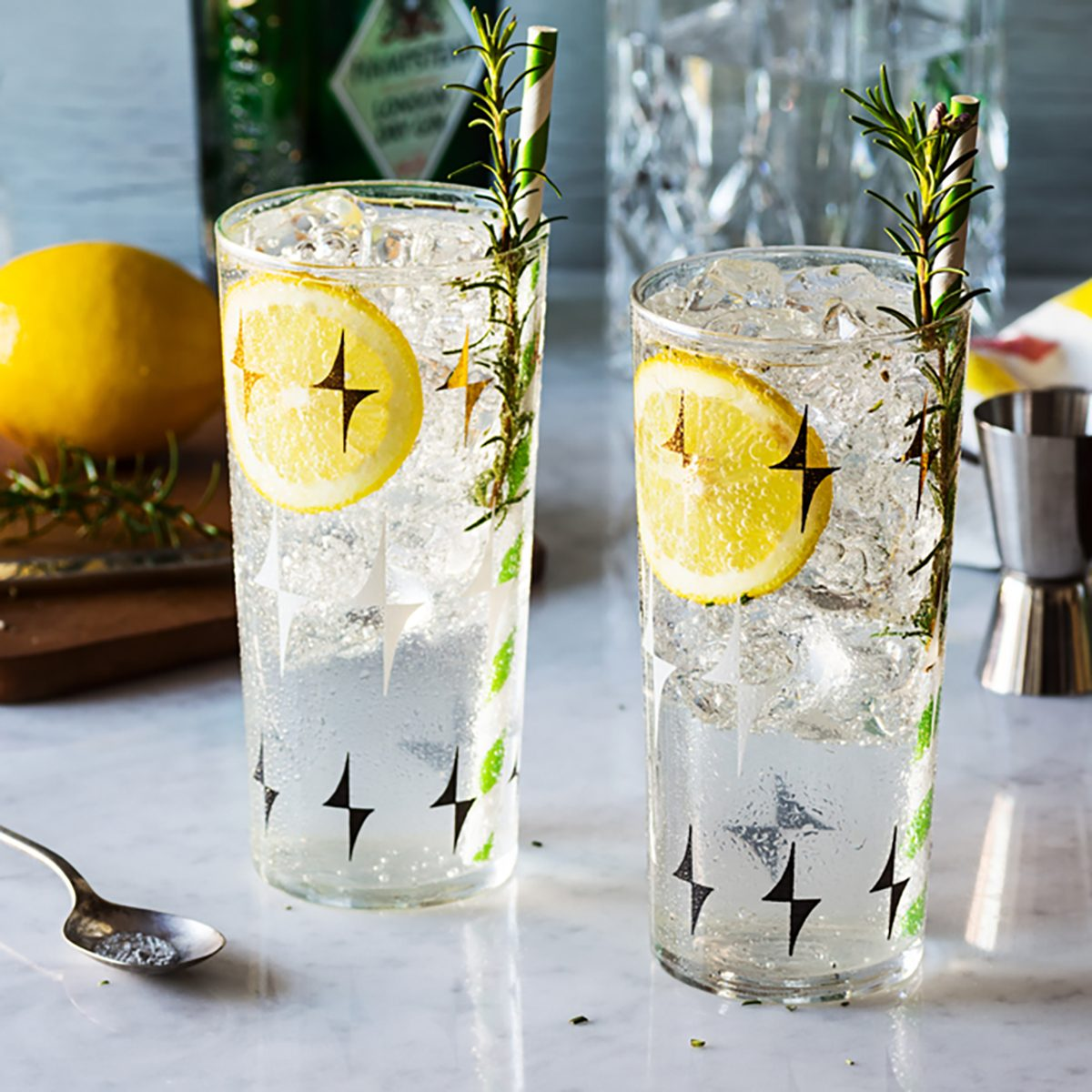 Rosemary Lemon Gin Fizz Alcoholic Cocktail on Bar with Ingredients; Shutterstock ID 362843429