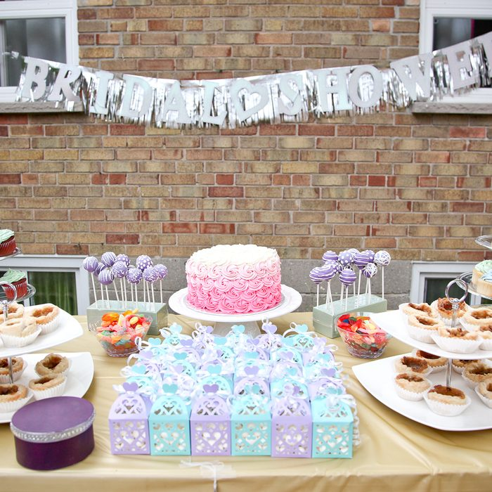 bridal shower party dessert table with party favors