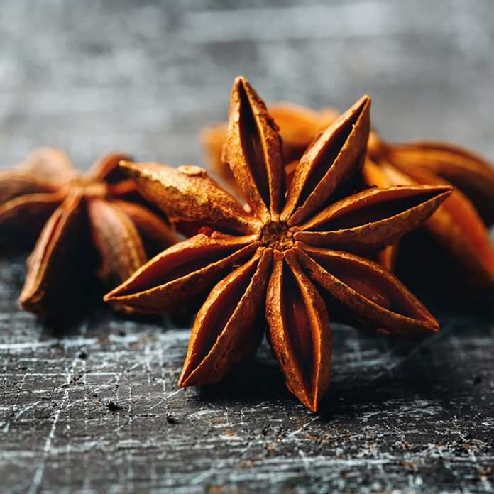 Food Background with Close-up of Star Anise on Vintage Black Table. Selective Focus. ; Shutterstock ID 396111676; Job (TFH, TOH, RD, BNB, CWM, CM): Taste of Home