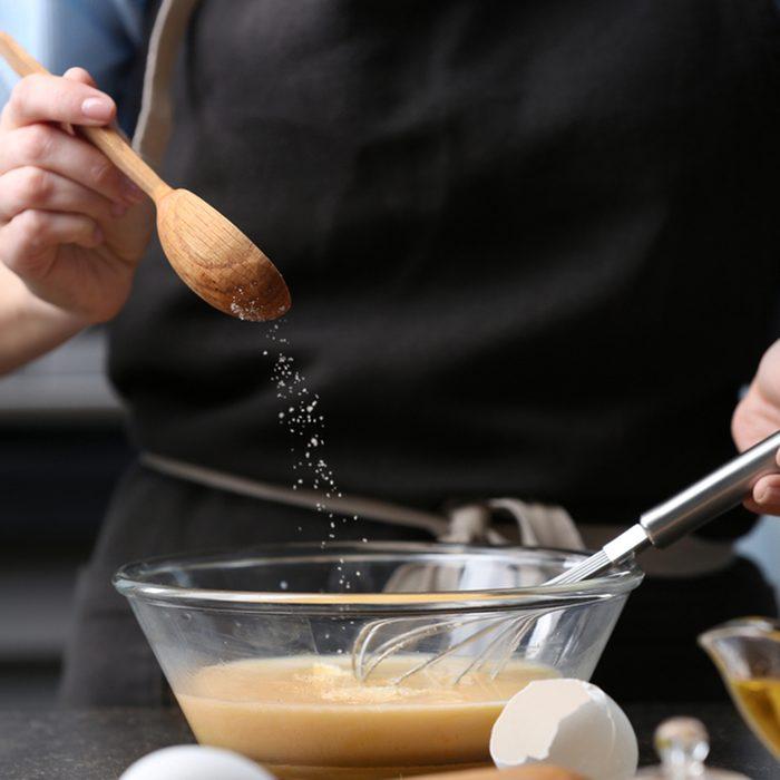 Young woman cooking in kitchen, closeup; Shutterstock ID 574318603; Job (TFH, TOH, RD, BNB, CWM, CM): TOH