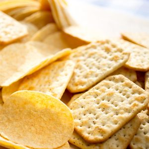 Chips and crackers scattered on the table