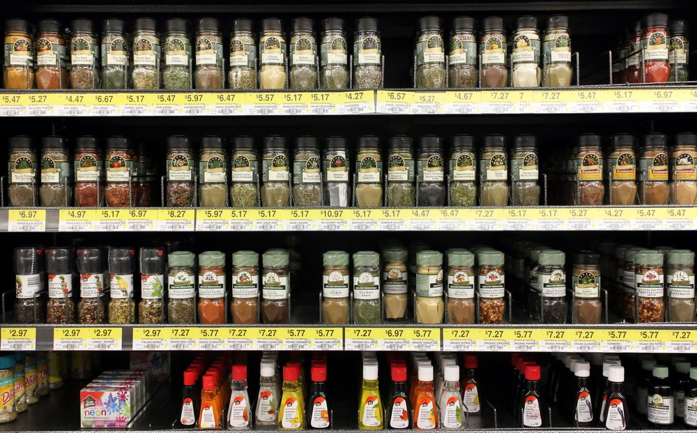 Various spices and seasoning powders on shelves in a supermarket. McCormick is one of the main manufactures spices, herbs, and flavorings in the world.